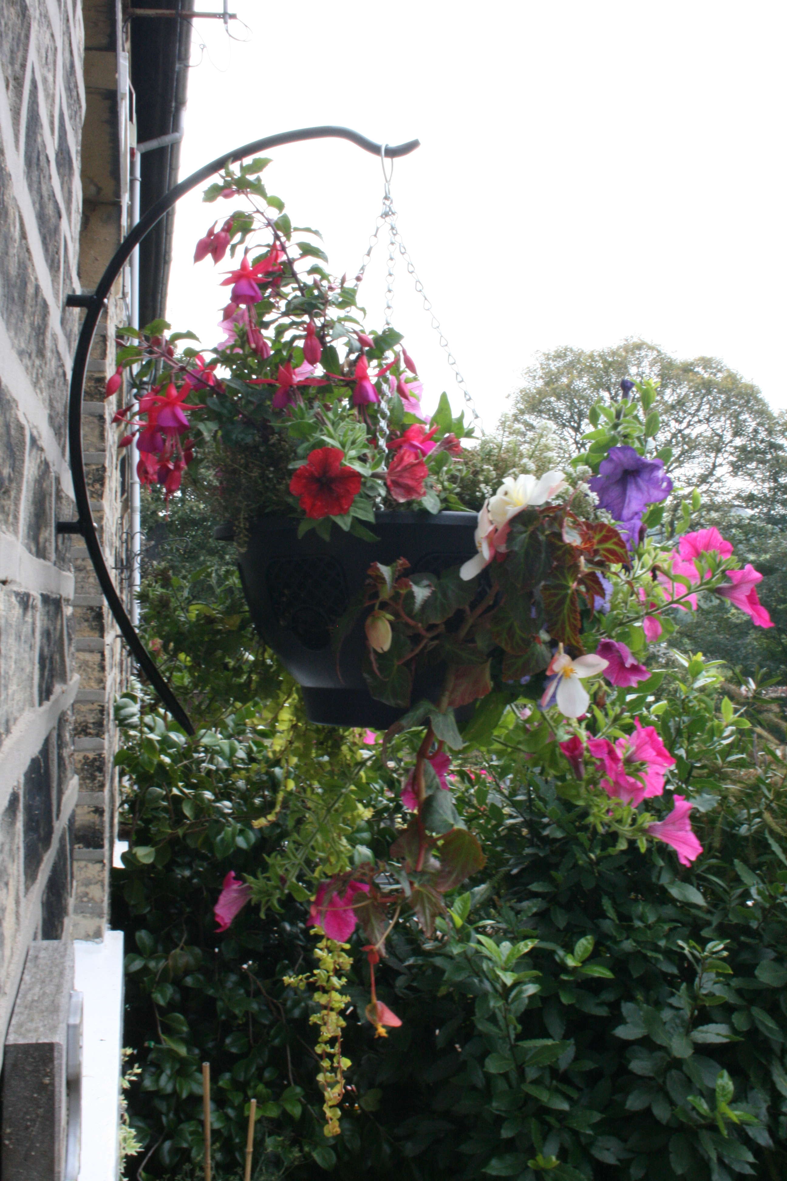 How to plant hanging baskets garden features ideas hanging basket brackets the holding arm garden features ideas mightylinksfo
